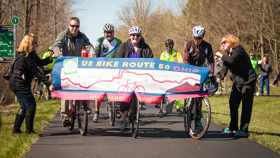 Bikers cross a banner at USBR 50 Ohio