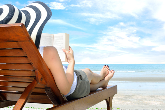 WomanReadingOnBeach