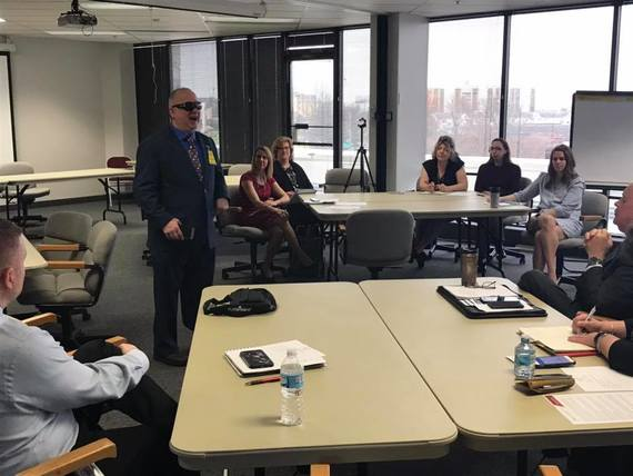 An image of Eric Duffy talking to OOD staff during a meeting