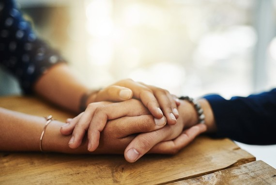 Photo of hands interlocked together