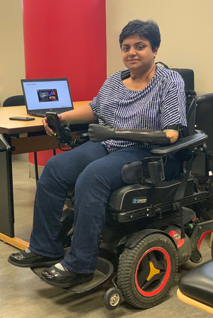 Sathya Gopalakrishnan an associate professor at OSU sitting in a wheelchair