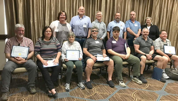 Veteran operators pictured with certificates at the conference