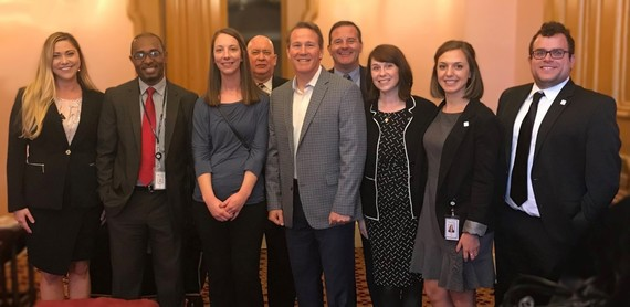 OOD staff pictured standing with Lt. Gov. Husted at the Ohio Statehouse