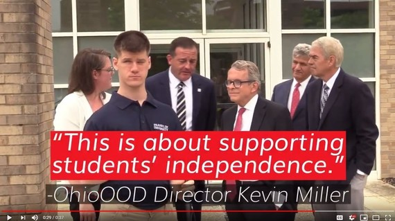 Pic links to video. Student Matthew with Gov. DeWine. Dir. Miller said this is about supporting independence.