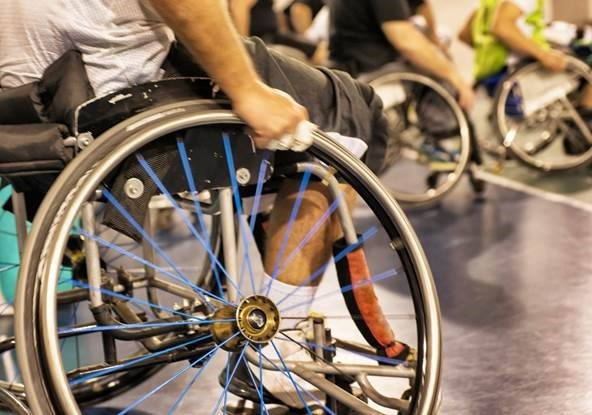 Photo of several wheel chair racers lined up for a race