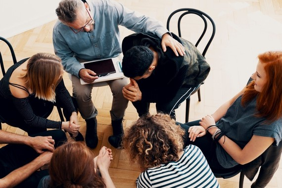 Various people sitting in a support group circle