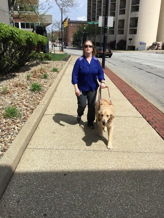 OOD's Berna King walking with her service dog Rex in Akron, Ohio
