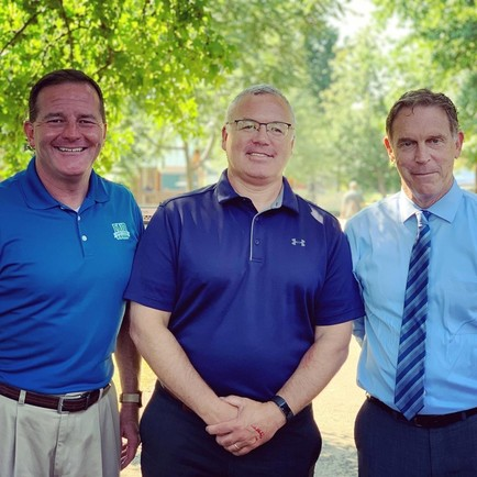 Pictured outdoors at DNR Park at the Ohio State Fair (trees in background): Kevin Miller, Shawn Henry, and Jeff Davis