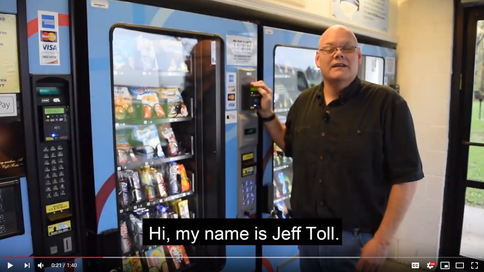 Jeff Toll standing in front of his vending machines