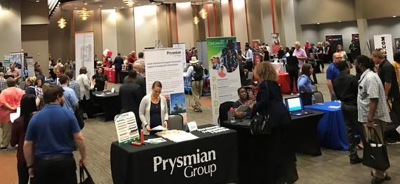 Long shot of employer tables and job seekers at Cincinnati Job Fair