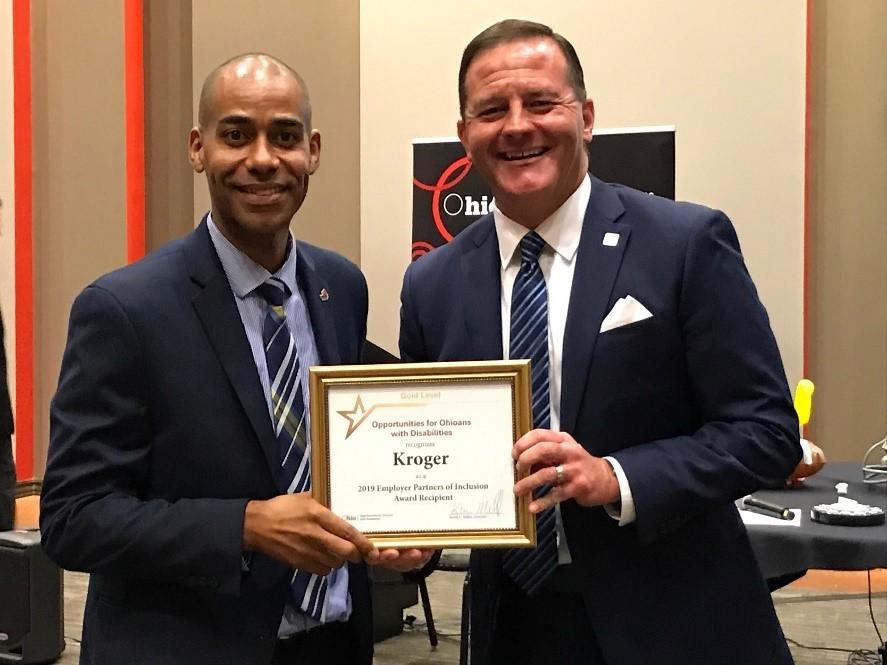 Director Kevin Miller presents award to Shawn Walker Senior Field Manager, Kroger