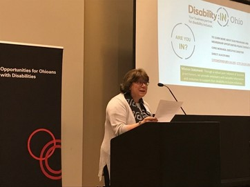 Photo of Chris Moranda of DisabilityIN speaking to employers at Cincinnati Job Fair