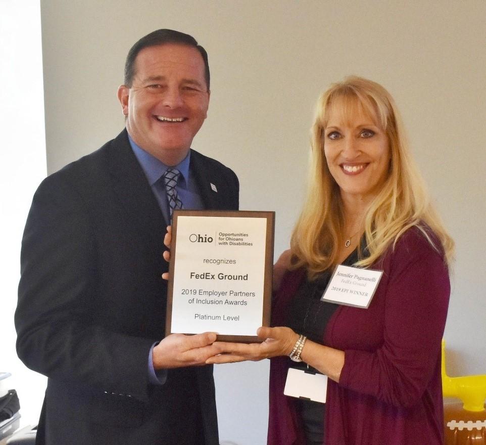 OOD Director Kevin Miller presents EPI Award to Jennifer Pagnanelli, Senior HR Business Partner for FedEX