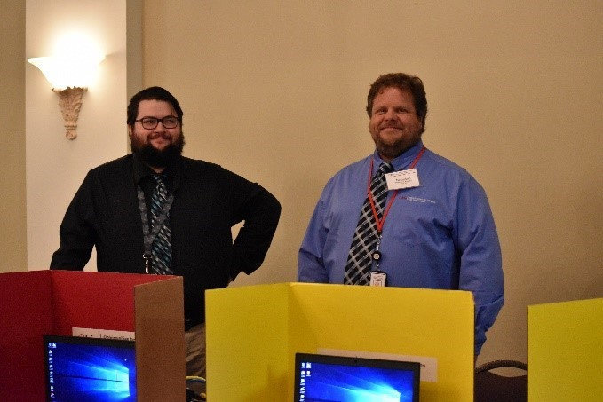 Photo of Eric Muller and Brandon Kramer from OOD Technologies helping at Job Fair