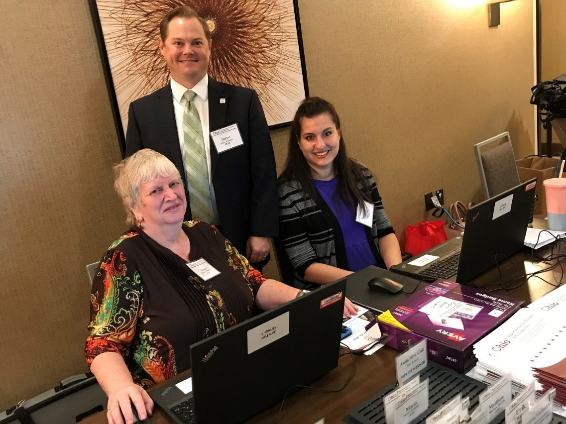 Photo of Susan Johnson, Steve Tribbie and Lauren Dalea at Registration Table at Canton Job Fair