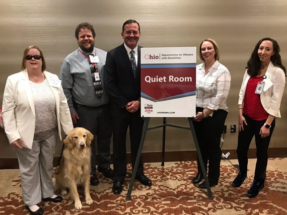 Photo of Berna King, Brandon Kramer, Director Kevin Miller, Christine Crine and Janelle Cookson next to quiet room sign at Canton Job Fair
