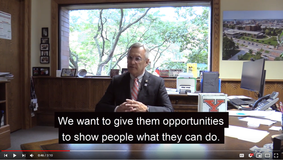 Screen shot of Youngstown State President Jim Tressel at his desk