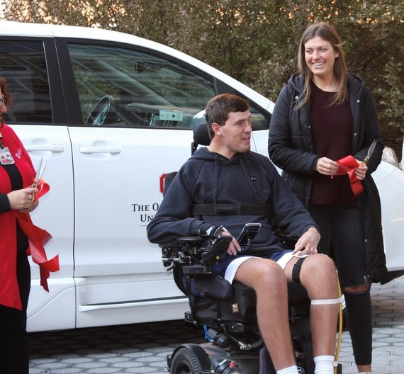 Photo of Ryan Custer and his sister in front of the OSU van