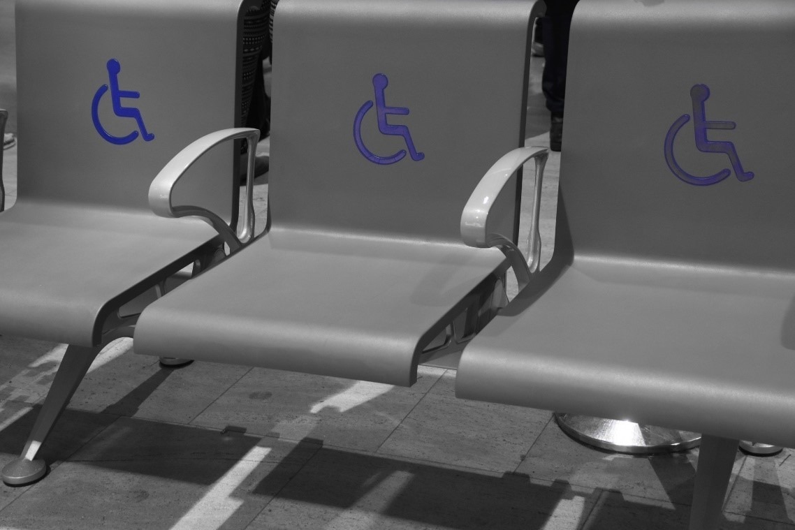 Image of gray chairs with accessible symbol on them