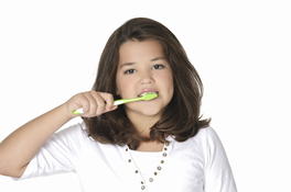 Young teen girl brushes teeth