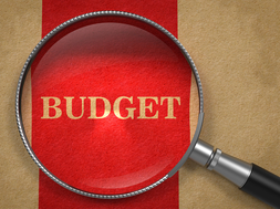 """The word """"budget"""" under a magnifying glass"""