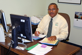 File Photo: Dr. Bragg sits at desk