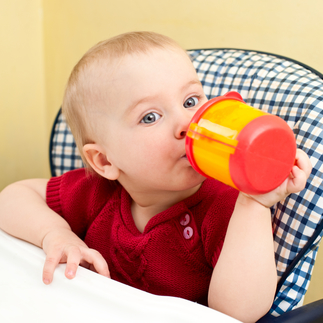 child holding sippy cups