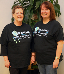 OHCA Dental Manager Tracy Matthews and Dental Analyst Sara Gillum wear their OkMOM shirts proudly on Thursday, March 1, 2018.