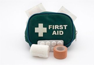 open green first aid bag with medicine showing