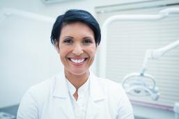 Close-up portrait of smiling female dentist at an independent practice