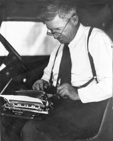 Will Rogers with typewriter