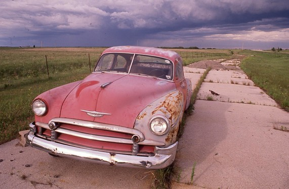 Route 66 car beside highway