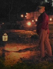 Man standing among lanterns at Hunter's Home