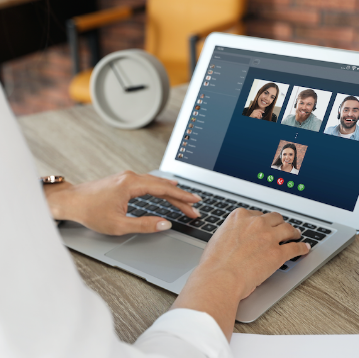 Stock image of a person joining a virtual meeting from a laptop