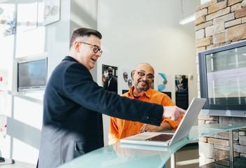 man pointing at laptop