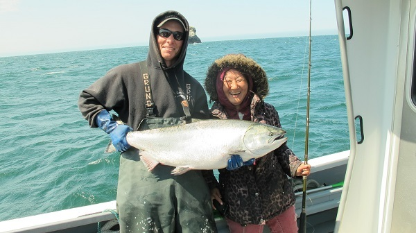 Saltwater sport angler with salmon
