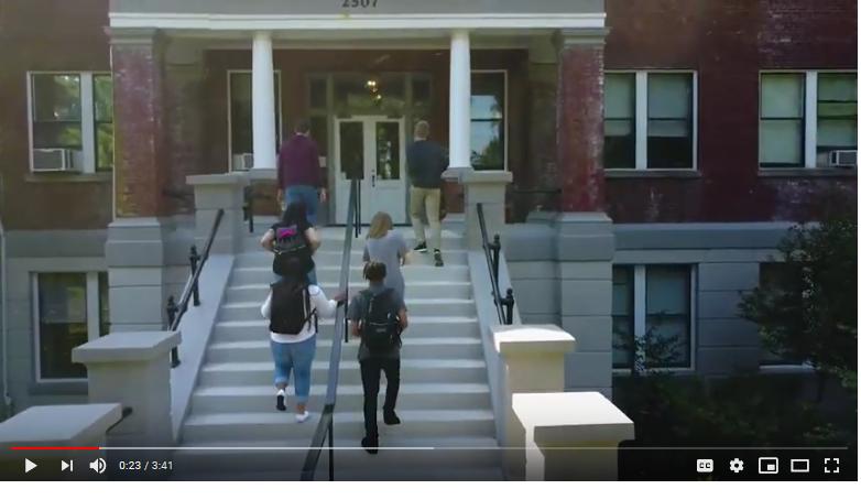 students approaching school doorway