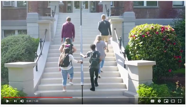 students walking up school steps