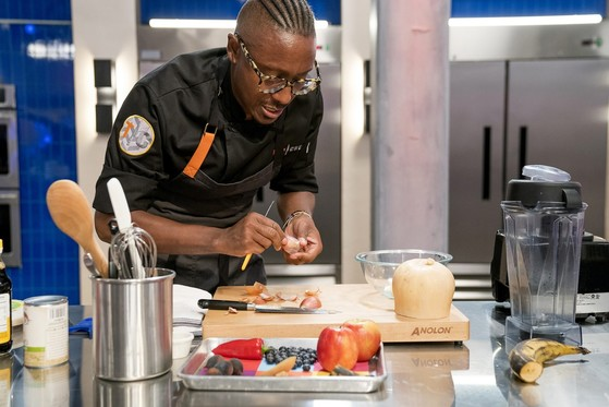 Chef Gourdet is pictured below making his Butternut Squash Soup with Cashew Cream and Smokey Pepper