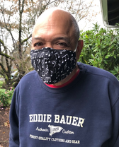 photo of bill diez wearing a mask with musical notes