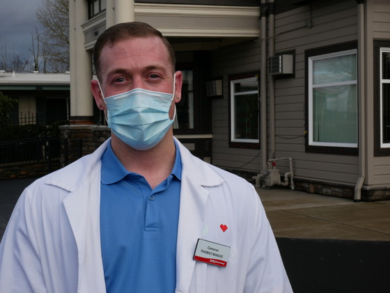 CVS Pharmacy Manager, Cameron Schmitt, stands in front of Village Manor where a COVID-19 vaccination clinic was held today