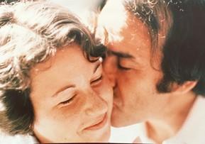 Close up of man kissing child's cheek.