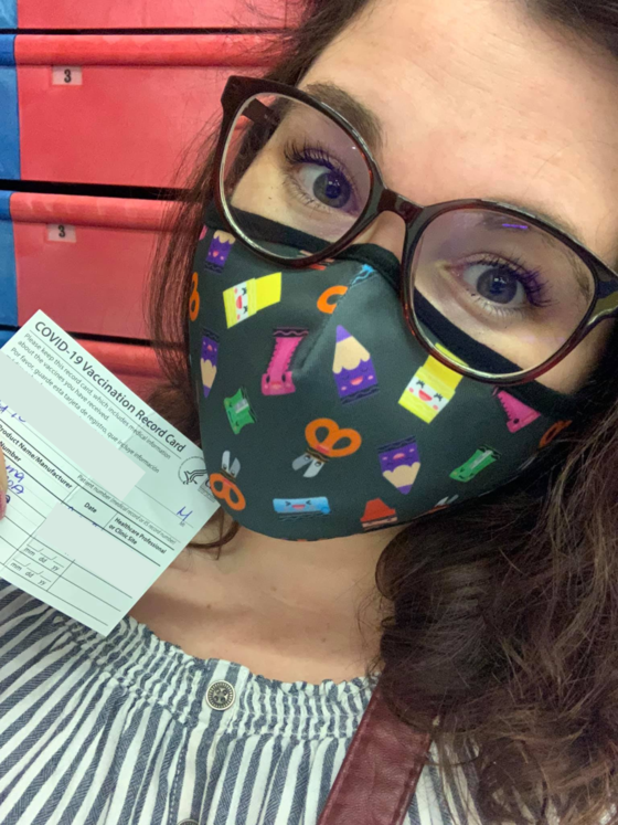 Brittany Morris with a blurred out vaccine card