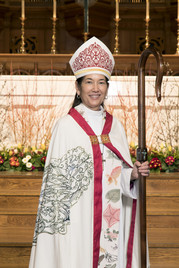 Woman wearing episcopal vestments.
