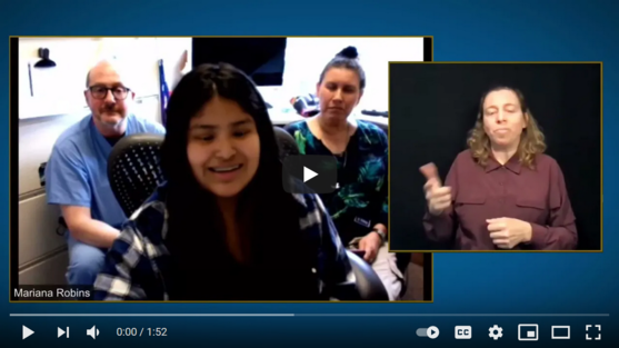 Screenshot of YouTube video of young person talking with parents behind her and an inset of ASL interpreter.