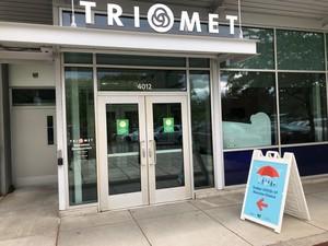 Sandwich board clinic sign in front of TriMet office.