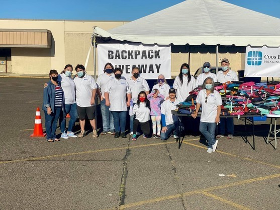 Staff and volunteers at the backpack giveaway