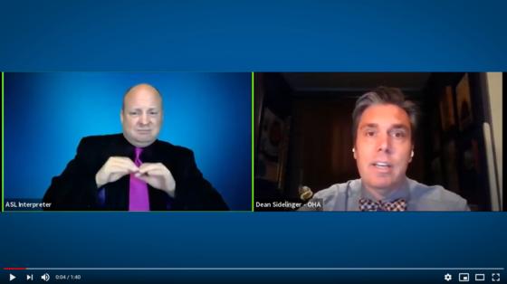 Video screenshot of ASL interpreter and Dr. Sidelinger