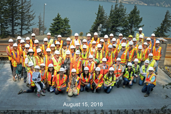 Attendees of a construction tour pose for a photo.