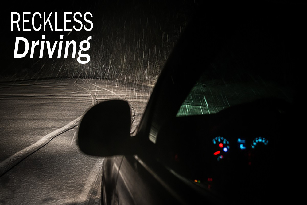 Car driving at night in the rain, reckless driving